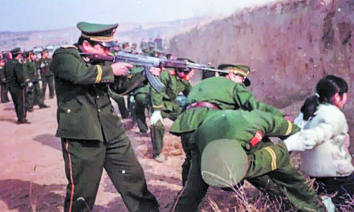 A woman before being executed by a communist soldier in China in this file photo.