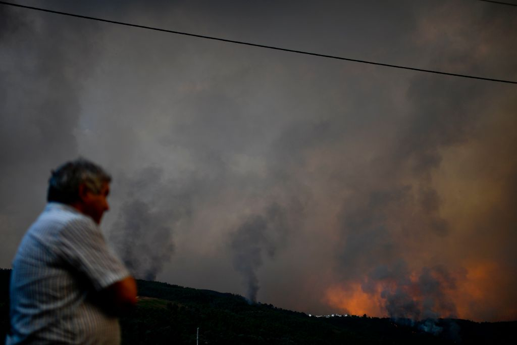 A man watches a wildfire in the village of Carvalhal, in Gois on June 20, 2017. (PATRICIA DE MELO MOREIRA/AFP/Getty Images)