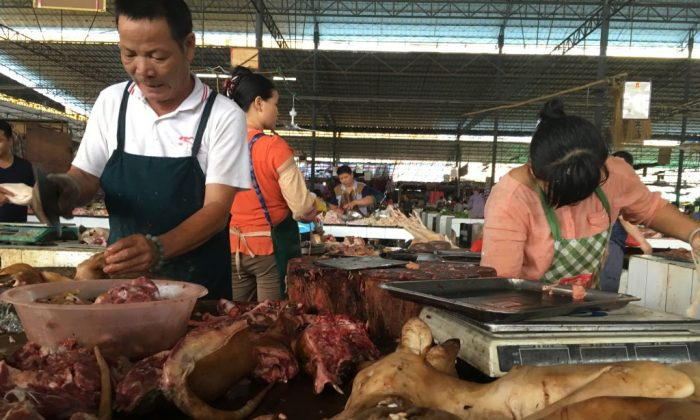 A vendor chops dog meat at the Nanqiao market in Yulin, in China's southern Guangxi region on June 21, 2017. China's most notorious dog meat festival opened in Yulin on June 21 with butchers hacking slabs of canines and cooks frying the flesh following rumours that authorities would impose a ban this year.(Becky Davis/AFP/Getty Images)
