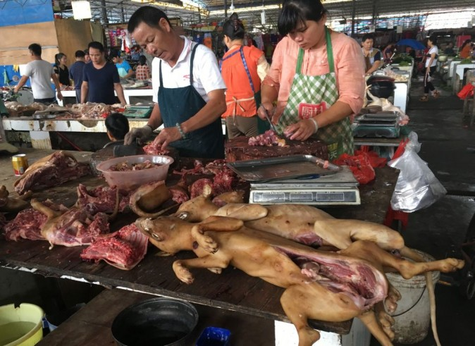 Vendors prepare dog meat at the Nanqiao market in Yulin, in China's southern Guangxi region on June 21, 2017. (Becky Davis/AFP/Getty Images)