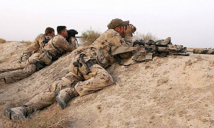 A Canadian sniper team scan the landscape in the Panjwayi district of southern Kandahar province in Afghanistan in 2006. (John D. McHugh/AFP/Getty Images)