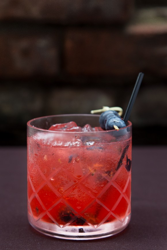 The Jack Rabbit with Applejack whiskey, blueberries, grenadine, and lemon. (Courtesy of Bedford and Co.)