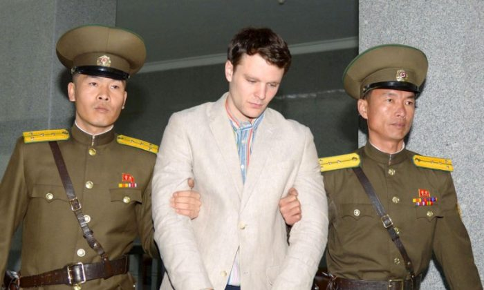 Otto Frederick Warmbier (C), a University of Virginia student who was detained in North Korea since early January, is taken to North Korea's top court in Pyongyang, North Korea, in this photo released by Kyodo March 16, 2016.        (Kyodo/Reuters)