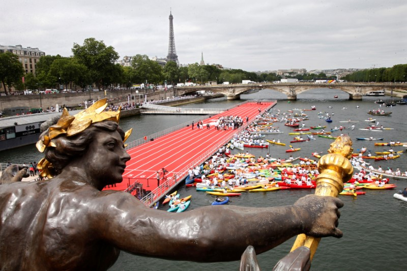 A general view from the Pont Alexandre III bridge shows an athletics track on the River Seine, with the Eiffel tower in the background, in Paris, France, June 23, 2017 as Paris is transformed into a giant Olympic park to celebrate International Olympic Days with a variety of sporting events for the public across the city during two days as the city bids to host the 2024 Olympic and Paralympic Games.  REUTERS/Charles Platiau