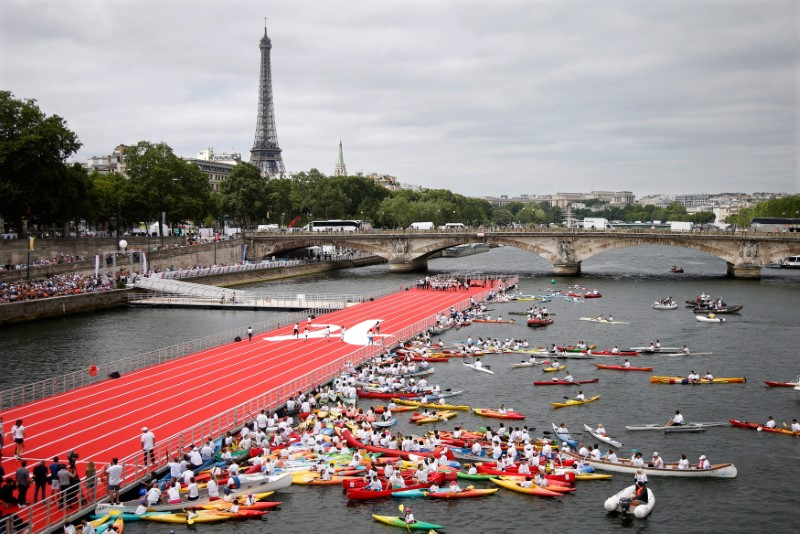 A general view from the Pont Alexandre III bridge shows an athletics track that floats on the River Seine, with the Eiffel tower in the background, in Paris, France, June 23, 2017 as Paris is transformed  into a giant Olympic park to celebrate International Olympic Days with a variety of sporting events for the public across the city during two days as the city bids to host the 2024 Olympic and Paralympic Games.  REUTERS/Charles Platiau