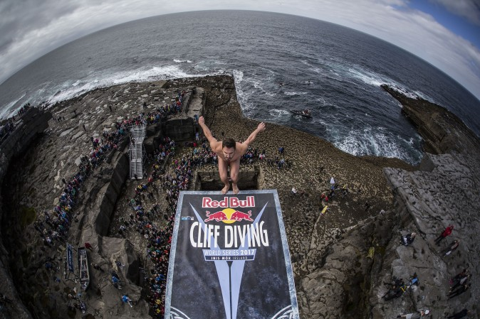 Blake Aldridge of the UK dives from the 90 foot platform at the Serpent`s Lair during the first stop of the Red Bull Cliff Diving World Series Inis Mor, Ireland, on June 25. (Romina Amato/Red Bull via Getty Images)