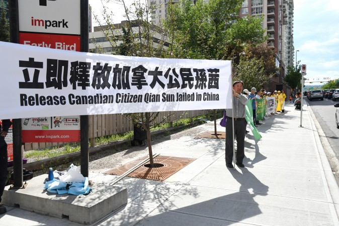 Falun Gong practitioners  gather in front of the Chinese Consulate in Calgary to appeal for the release of Canadian citizen Sun Qian, who has been detained in China since Feb. 19 for her faith in Falun Gong. (The Epoch Times)