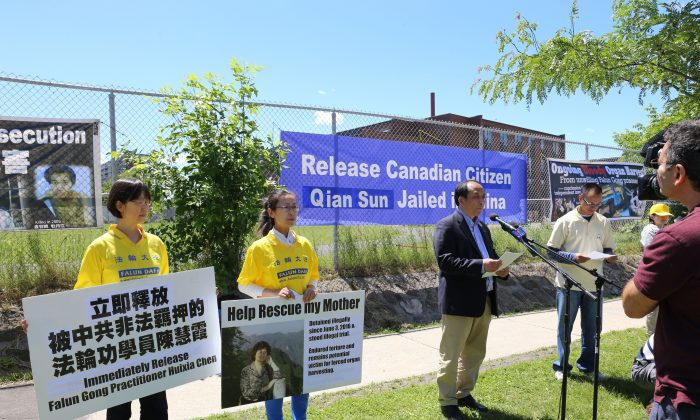 Falun Dafa Association of Canada president Li Xun speaks during a rally outside the Chinese Embassy in Ottawa on June 26, 2017, calling for the release of Canadian citizen Sun Qian who is currently detained in China for practising Falun Gong. (Donna He/The Epoch Times)