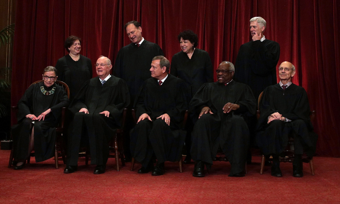 Front row from left, U.S. Supreme Court Associate Justice Ruth Bader Ginsburg, Associate Justice Anthony M. Kennedy, Chief Justice John G. Roberts, Associate Justice Clarence Thomas, and Associate Justice Stephen Breyer, back row from left, Associate Justice Elena Kagan, Associate Justice Samuel Alito Jr., Associate Justice Sonia Sotomayor, and Associate Justice Neil Gorsuch pose for a group portrait in the East Conference Room of the Supreme Court June 1, 2017 in Washington, DC. The U.S. Supreme Court held a photo opportunity for photographers after Justice Gorsuch has joined as the newest member.  (Alex Wong/Getty Images)