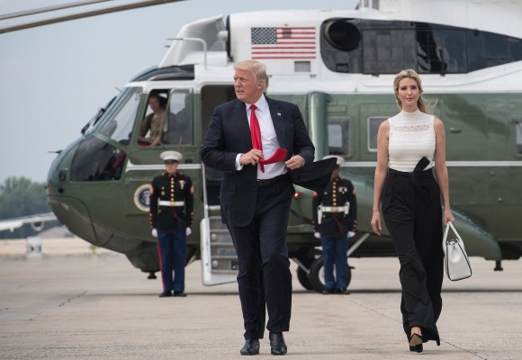 US President Donald Trump waves as he walks with his daughter Ivanka to board Air Force one at Andrews Air Force Base in Maryland on June 13, 2017 en route to Milwaukee, Wisconsin.(NICHOLAS KAMM/AFP/Getty Images)