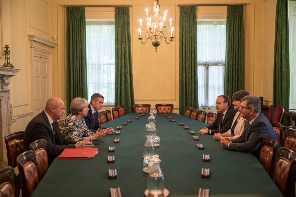Prime Minister Theresa May (2L) sits with First Secretary of State Damian Green (L), and Parliamentary Secretary to the Treasury, and Chief Whip, Gavin Williamson (3L) as they talk with Democratic Unionist Party (DUP) leader Arlene Foster (2R), DUP Deputy Leader Nigel Dodds (3R), and DUP MP Jeffrey Donaldson, inside 10 Downing Street in London, England on June 26, 2017. (Jack Hill - WPA Pool /Getty Images)