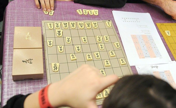 Two visitors play the Japanese Shogi game during the 4th edition of the Toulouse Game Show (TGS), southwestern France. (REMY GABALDA/AFP/Getty Images)