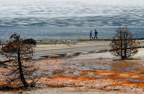 Tourist walk beside Yellowstone Lake at the West Thumb Geyser Basin in the Yellowstone National Park, Wyoming on June 2, 2011. (MARK RALSTON/AFP/Getty Images)