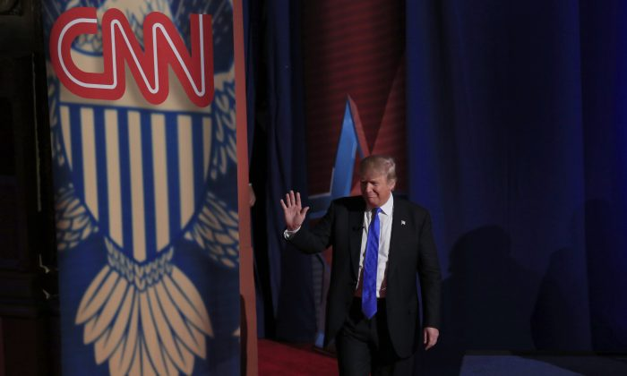 File Photo: Republican Presidential candidate Donald Trump enters the stage as he takes part in a town hall event moderated by Anderson Cooper March 29, 2016 in Milwaukee, Wisconsin. (Photo by Darren Hauck/Getty Images)