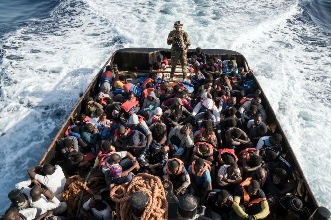 A Libyan coast guardsman is on a boat during the rescue of 147 illegal immigrants attempting to reach Europe off the coastal town of Zawiyah, 45 kilometres west of the capital Tripoli, on June 27. (TAHA JAWASHI/AFP/Getty Images)