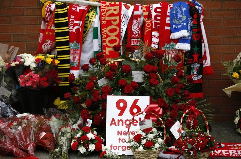Tributes for the 96 victims of the Hillsborough disaster are seen at Anfield in Liverpool, Britain on April 15, 2016. (REUTERS/Phil Noble)