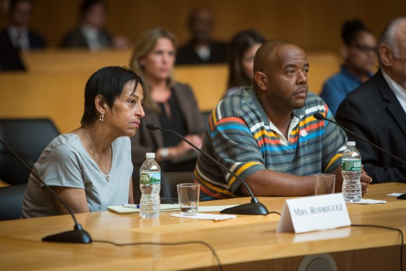 Evelyn Rodriquez (L) and Robert Mickens during a congressional hearing on MS-13 gang violence in Central Islip, Long Island, N.Y., on June 20, 2017. (Benjamin Chasteen/The Epoch Times)