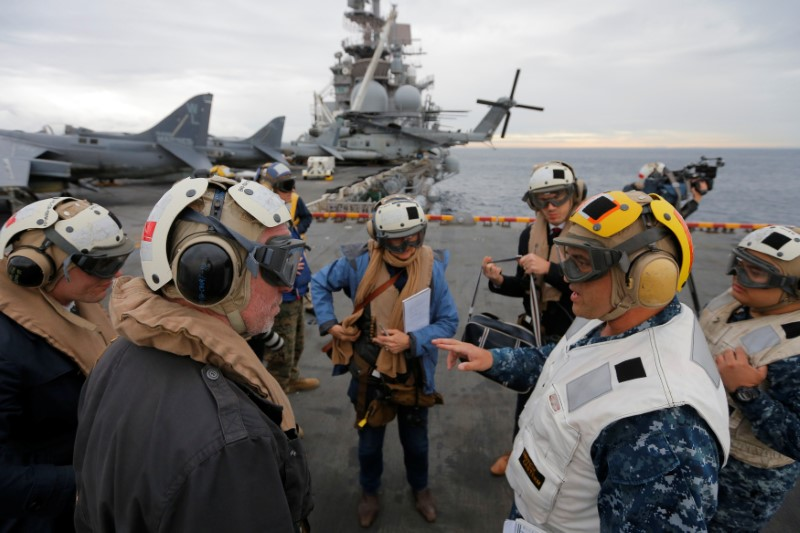 USS Bonhomme Richard amphibious assault ship Executive Officer Rich Lebron (2nd R) speaks to Australian journalists in the Pacific Ocean off the coast of Sydney, Australia, before a ceremony marking the start of Talisman Saber 2017, a biennial joint military exercise between the United States and Australia June 29, 2017.  REUTERS/Jason Reed