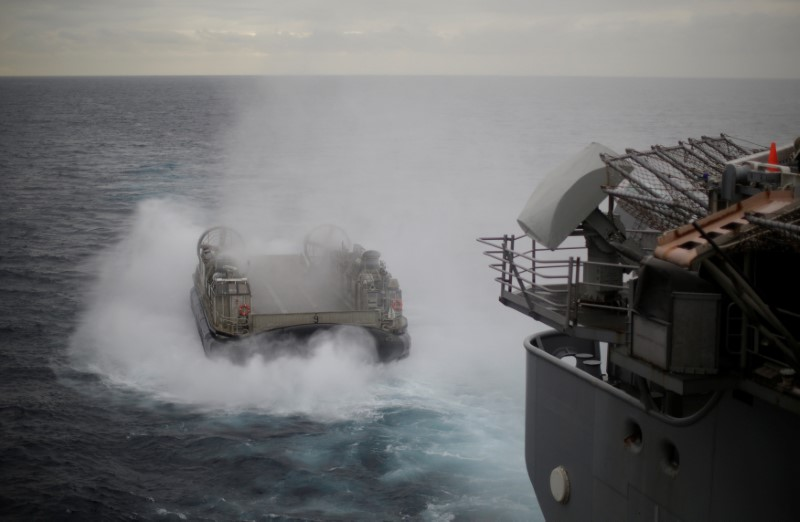 A U.S. Navy Landing Craft Air Cushion (LCAC) appears from the stern of the USS Bonhomme Richard amphibious assault ship during events marking the start of Talisman Saber 2017, a biennial joint military exercise between the United States and Australia, off the coast of Sydney, Australia July 29, 2017. REUTERS/Jason Reed