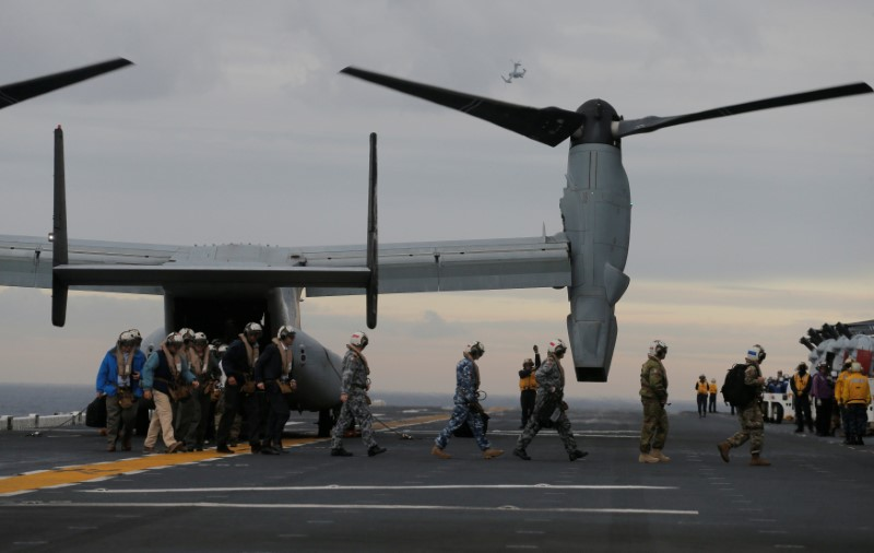 Participants in a ceremony marking the start of Talisman Saber 2017, a biennial joint military exercise between the United States and Australia, arrive on a U.S. Marines MV-22B Osprey Aircraft on the deck of the USS Bonhomme Richard amphibious assault ship off the coast of Sydney, Australia, June 29, 2017.   REUTERS/Jason Reed