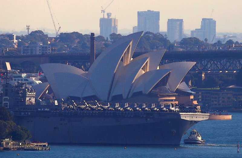 The USS Bonhomme Richard amphibious assault ship manoeuvres into port in front of the Sydney Opera House in Australia, June 29, 2017 after a ceremony on board the ship marking the start of Talisman Saber 2017, a biennial joint military exercise between the United States and Australia.    REUTERS/David Gray