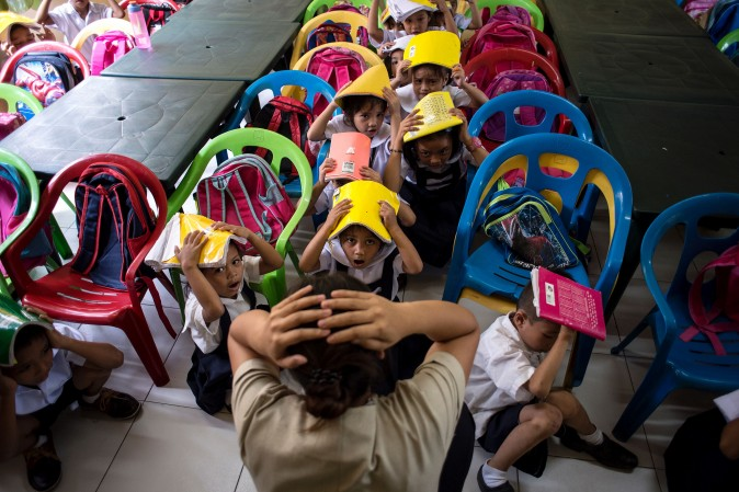 Schoolchildren from the Corazon Aquino Elementary School participate in a nationwide earthquake drill in Manila on June 29. The nationwide drill is part of the Philippine government's disaster preparedness program and is held quarterly. (NOEL CELIS/AFP/Getty Images)