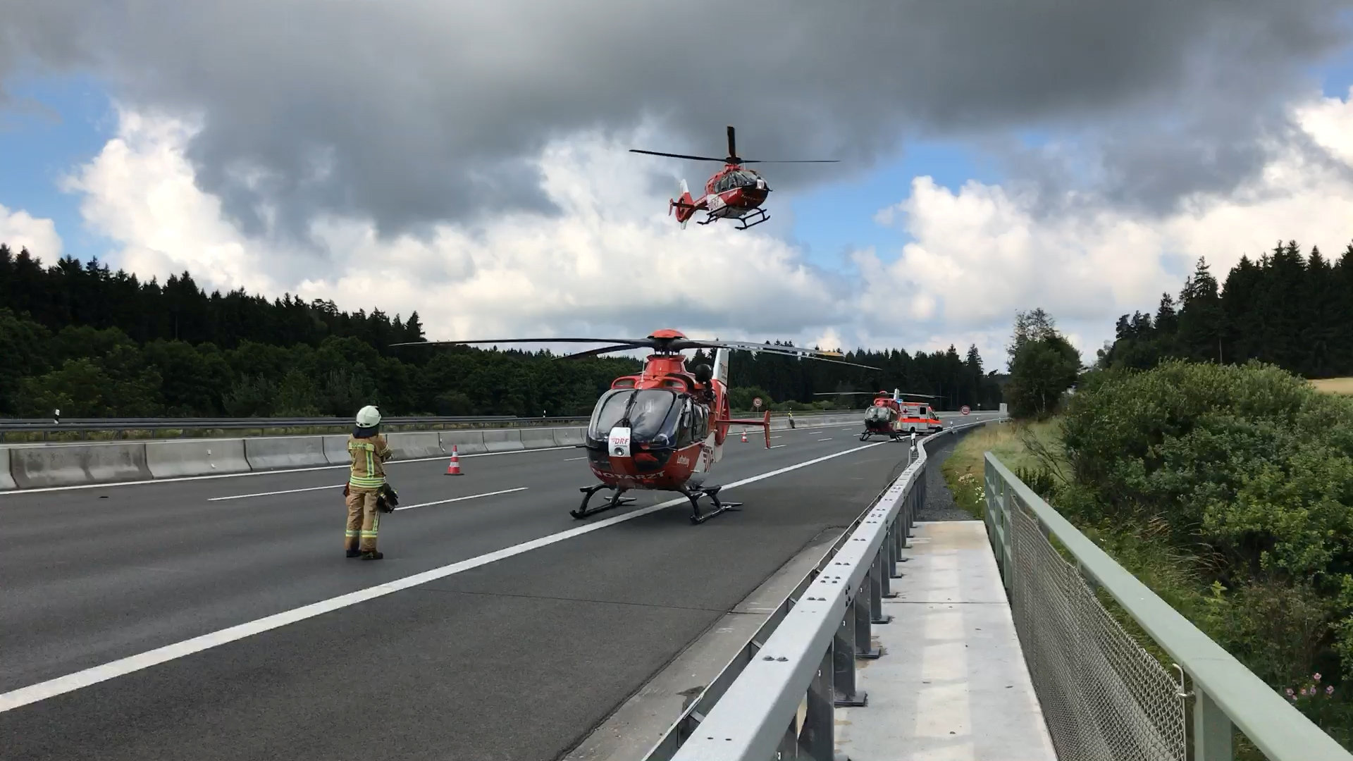 Helicopters at the site where a coach burst into flames after colliding with a lorry on a motorway near Muenchberg, Germany on July 3, 2017. (REUTERS/News 5.)