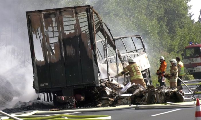 Firefighters are seen at the site where a coach burst into flames after colliding with a lorry on a motorway near Muenchberg, Germany in this still image taken from video on July 3, 2017. (REUTERS/News 5)
