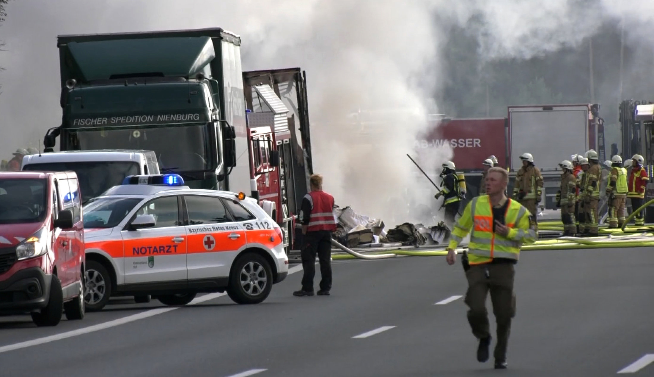 Firefighters are seen at the site where a coach burst into flames after colliding with a lorry on a motorway near Muenchberg, Germany in this still image taken from video on July 3, 2017. REUTERS/News 5.