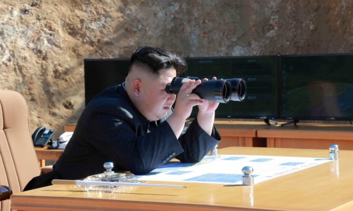 North Korean leader Kim Jong Un looks on during the test-fire of inter-continental ballistic missile Hwasong-14. (KCNA/via REUTERS)