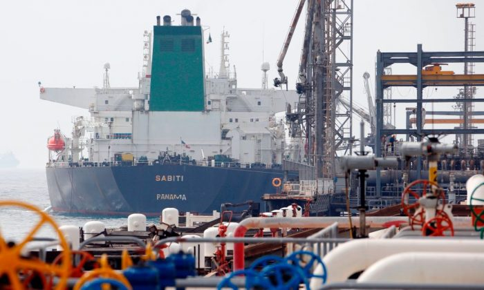 A Panamanian tanker docking at the platform of the oil facility in the Khark Island, on the shore of the Gulf on on March 12, 2017. (ATTA KENARE/AFP/Getty Images)