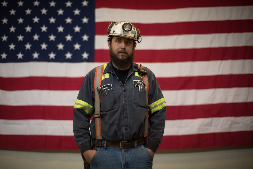 Donnie Claycomb, 27, of Limestone, West Virginia., who has been mining for 6 years, stands in front of an American flag prior to an event with U.S. Environmental Protection Agency Administrator Scott Pruitt at the Harvey Mine in Sycamore, Pennsylvania on April 13, 2017. (Justin Merriman/Getty Images)