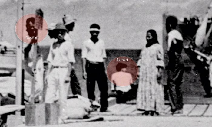A newly discovered photo shows a woman who resembles Amelia Earhart and a man who appears to be her navigator, Fred Noonan. (National Archives)