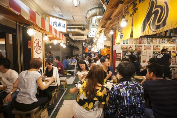 The Ebisu Yokocho is boisterous and energetic, filled with young Japanese wiling the evening away. (Annie Wu/The Epoch Times)