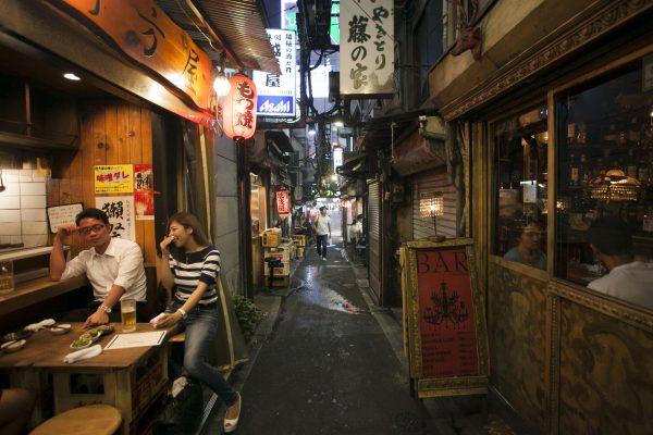 The Omoide Yokocho (alleyway) in the Shinjuku neighborhood of Tokyo promises good times, homey Japanese food, and plenty of booze. (Annie Wu/The Epoch Times)