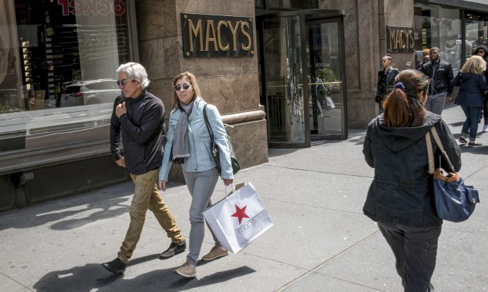 A woman carries a Macy's shopping bag after exiting Macy's flagship store in New York on May 12, 2017. (Drew Angerer/Getty Images)