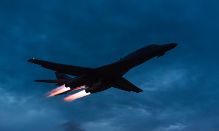 A U.S. Air Force B-1B Lancer assigned to the 9th Expeditionary Bomb Squadron, deployed from Dyess Air Force Base, Texas, takes off from Andersen Air Force Base, Guam to fly a bilateral mission with two Japan Air Self-Defense Force F-15's over the East China Sea, July 6, 2017. (U.S. Air Force photo by Airman 1st Class Jacob Skovo)