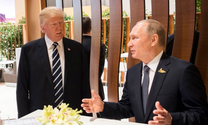 Donald Trump meets Vladimir Putin during the G20 Summit on July 7, 2017 in Hamburg, Germany.  (Photo by BPA via Getty Images)