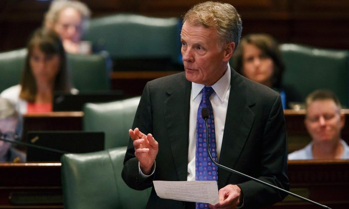 Illinois Speaker of the House Michael Madigan, D-Chicago, gives a speech following the Illinois House voting to override Gov. Rauner's veto and pass a budget for the first time in two years during the overtime session at the Illinois State Capitol, Thursday, July 6, 2017, in Springfield, Ill. (Justin L. Fowler /The State Journal-Register via AP)