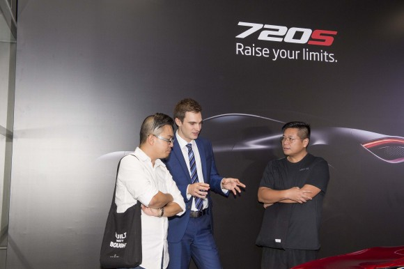 Peter Sell Regional Sales Manager of McLaren Automotive Asia talking with guests at the McLaren 720S at the Wanchai showroom during the launch event in Hong Kong on June 29, 2017. (Bill Cox/Epoch Times)