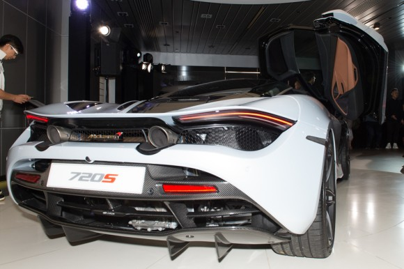 Rear view of the McLaren 720S showing the stability fins, an outline of the rear wing, the rear drive units are also just visible. (Bill Cox/Epoch Times)