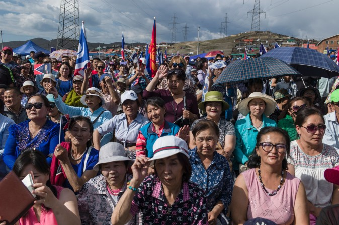 Mongolian supporters listen the speech of Mongolian presidential election candidate Battulga Khaltmaa from the Mongolian Democracy Party during a rally in Ulan Bator, on June 23, 2017. (Fred Dofour/AFP/Getty Images)