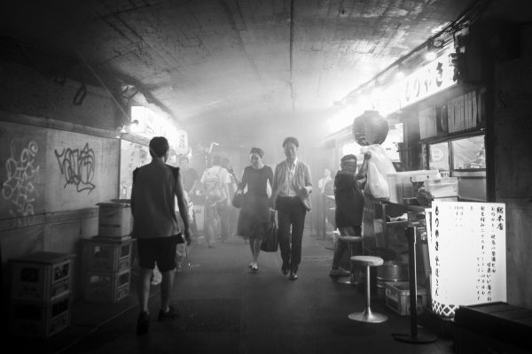 In the yokocho, smoke from the restaurant grills fills the air. (Annie Wu/The Epoch Times)