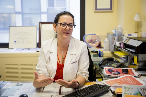 Deborah Ottenheimer, gynecologist and associate director of Mount Sinai Human Rights Clinic, talks about the dangers of female genital mutilation, at her clinic in New York, on June 13. (Samira Bouaou/The Epoch Times)