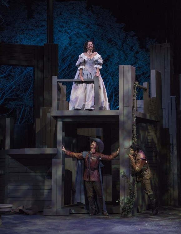 In the most famous scene of the play, (L–R) Roxane (Laura Rook) is wooed by Cyrano (James Ridge) for Christian (Danny Martinez) who lacks the ability to speak beautifully. (Michael Brosilow)
