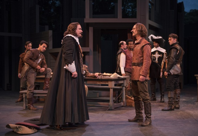 (L–R) The Count de Guiche (John Taylor Phillips), as a worldly cynic plays counterpoint to Cyrano de Bergerac's honor. (Michael Brosilow)