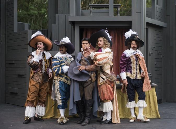 Christian de Neuvillette (Danny Martinez, C) surrounded by foppish courtiers: (L–R) Robert R. Doyle, Cage Sebastian Pierre, Marcus Truschinski, and Alejandro Cordoba. (Michael Brosilow)