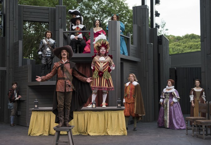 Cyrano (James Ridge, L-forward) is determined to stop the bad actor Montfleury (Brian Mani, C) from performing. (Michael Brosilow)