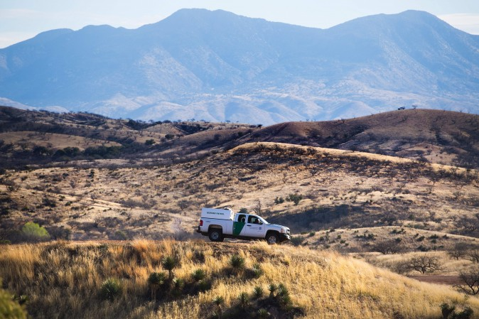 A U.S. Border Patrol agent parks on a hill top near the border fence in Nogales, Arizona, on February 17, 2017, on the US/Mexico border. (Jim Watson/AFP/Getty Images)