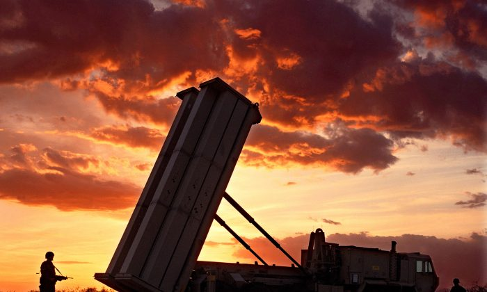 "The Pentagon again postponed a key test of its troubled ""THAAD'''' anti-missile defense rocket, seen this file photo, due to a commercial power failure, the Defense Department said. (photo by Lockheed Martin)"